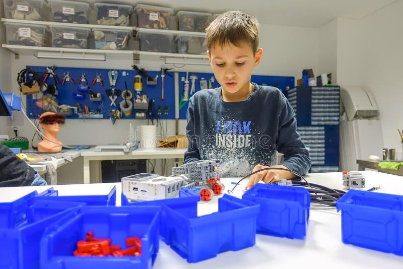 Vilnius, Lithuania - November 23, 2018: Kid making Lego robot mindstorms. Robotic, learning, technology, stem education. Vilnius, Lithuania - November 23, 2018 royalty free stock photos