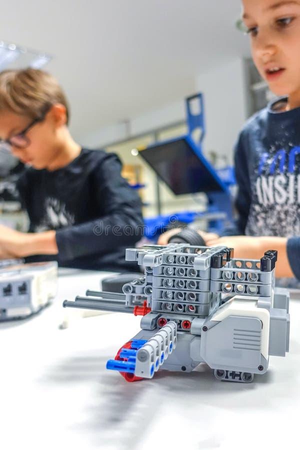 Vilnius, Lithuania - November 23, 2018: Kids making Lego robot mindstorms. Robotic, learning, technology, stem education. Vilnius, Lithuania - November 23, 2018 stock photography