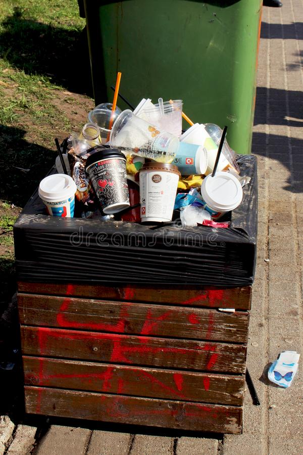 Vilnius Lithuania - 04 22 2019: Trash can full of coffee cups and plastic royalty free stock photos
