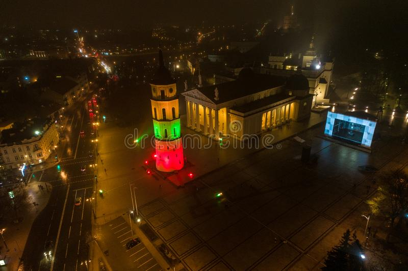 Vilnius old town with cathedral square and bell tower. Lithuanian flag color on the bell tower stock photography