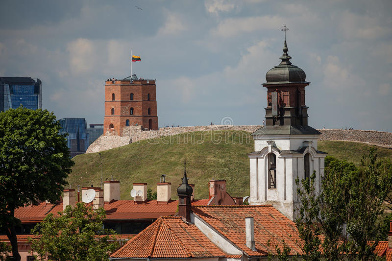 Vilnius old town cityscape with Gediminas castle and modern office buildings, Lithuania royalty free stock photo