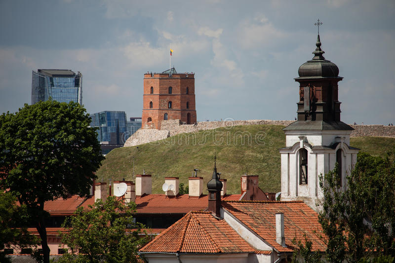 Vilnius old town cityscape with Gediminas castle and modern office buildings, Lithuania royalty free stock photography