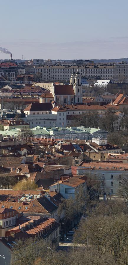 Vilnius town panorama at cold winter day. Vilnius old town panorama at cold winter day. Red tiled roofs, golden tops of towers, churches royalty free stock photography