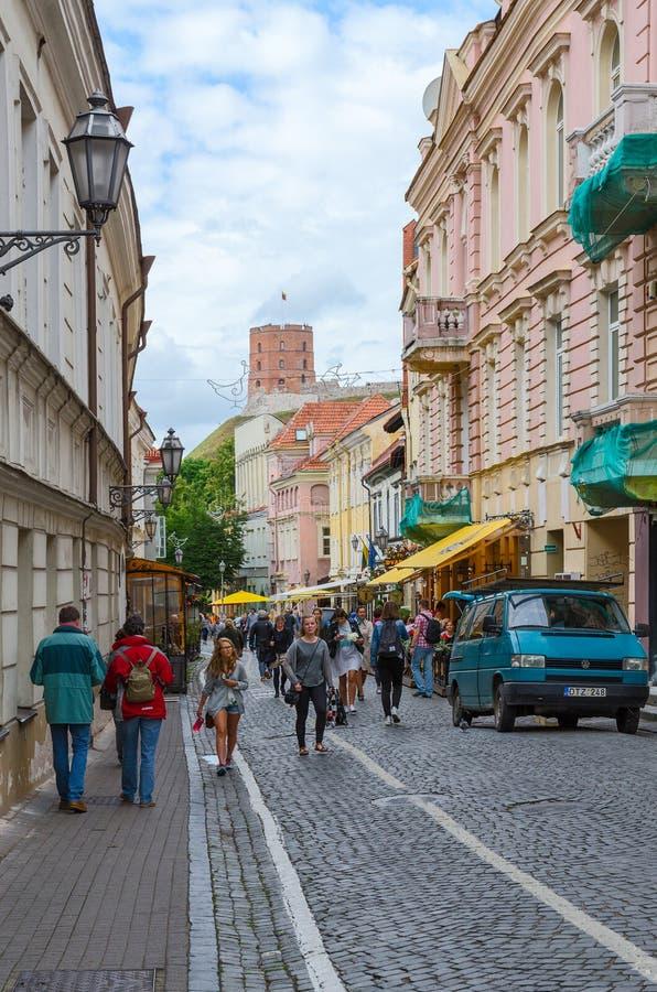 Vilnius, Old Town, Pilies Street (Zamkovaya Street), view of the. VILNIUS, LITHUANIA - JULY 10, 2015: Unidentified people walk along Pilies Street (Zamkovaya royalty free stock photos