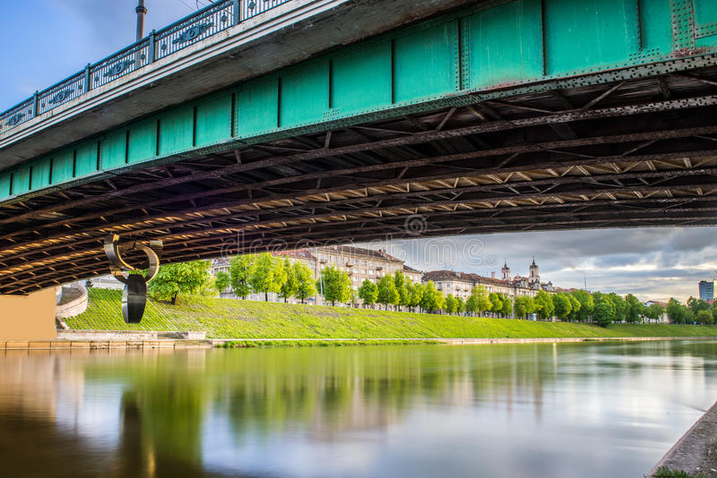 Vilnius under the bridge. With river Neris stock photos
