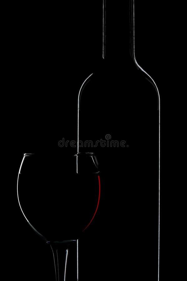 vin d'isolement de silhouette de verre à bouteilles photographie stock