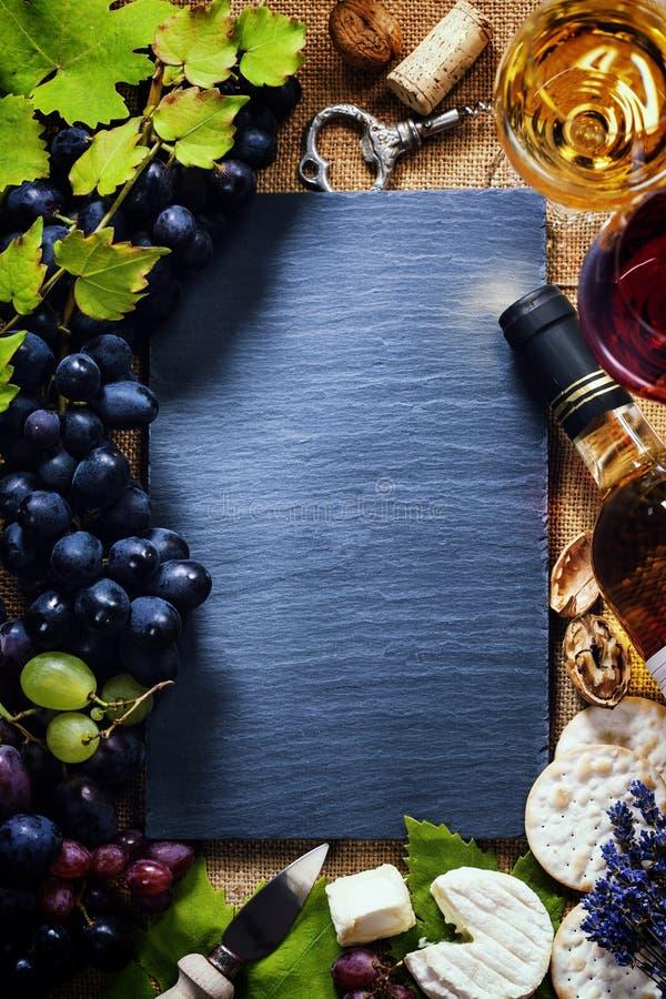 Vin, druva och ost fotografering för bildbyråer