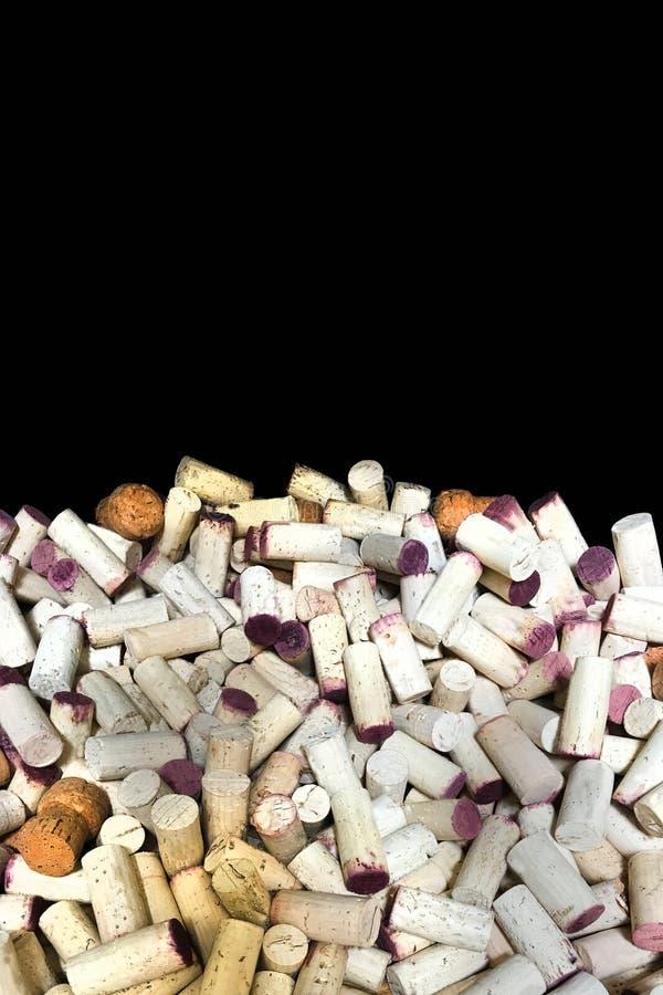 Vin korkar vertikal beröm för bakgrundssvart arkivfoto