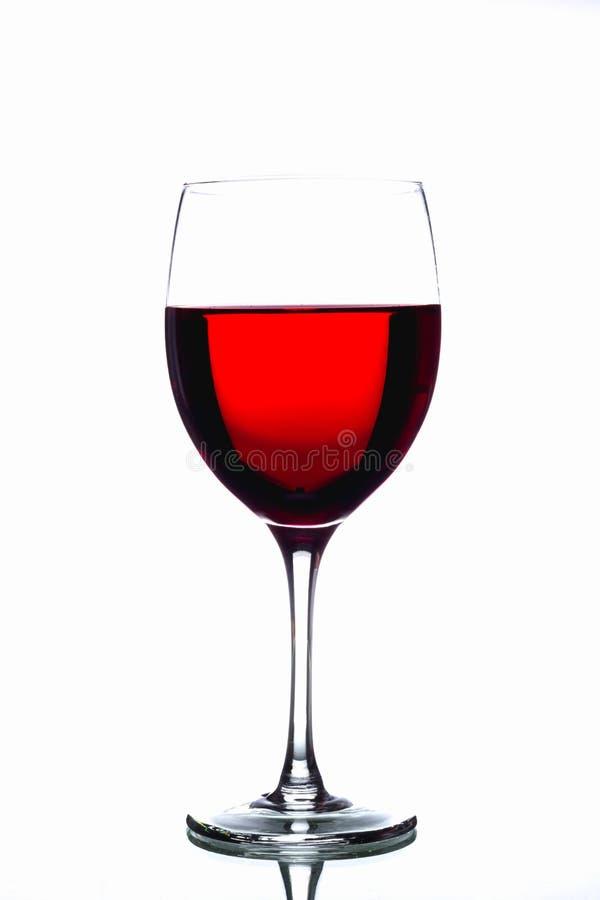 Vin rouge dans une glace image libre de droits