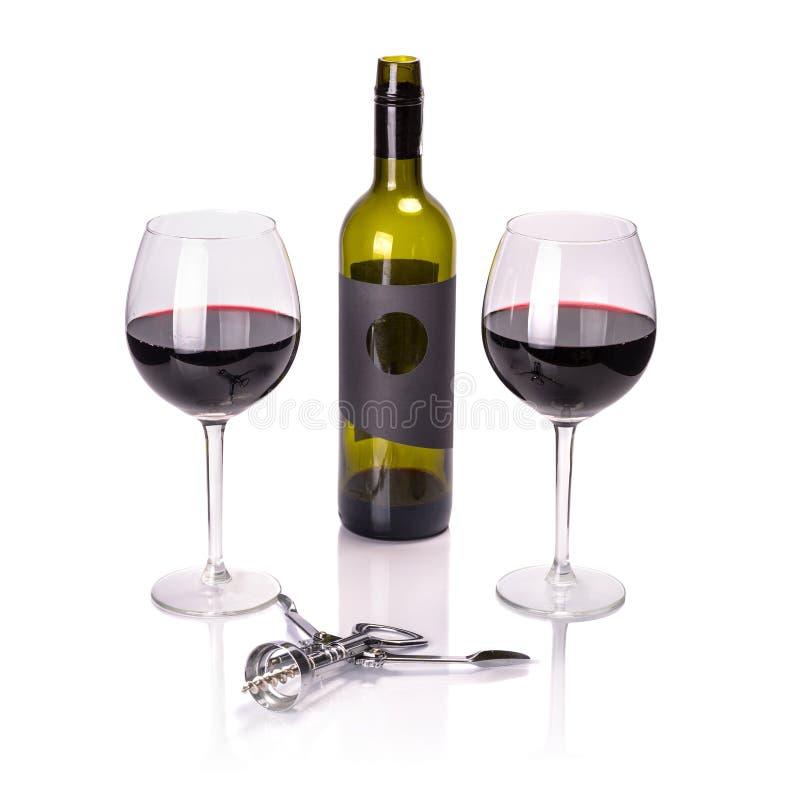 Vin rouge en verres avec la bouteille images stock