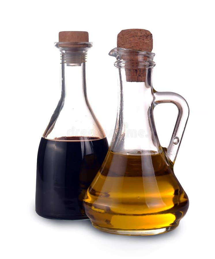 Vinaigre balsamique de Modène et de bouteilles supplémentaires en verre d'Olive Oil de Vierge photo stock