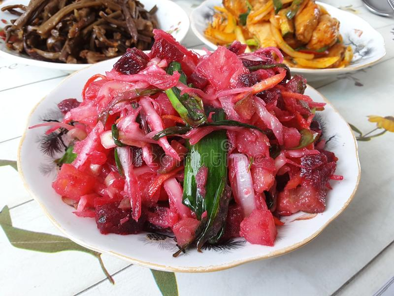 Vinaigrette salad on a plate. Festive dish. Vegetarian table. stock photography
