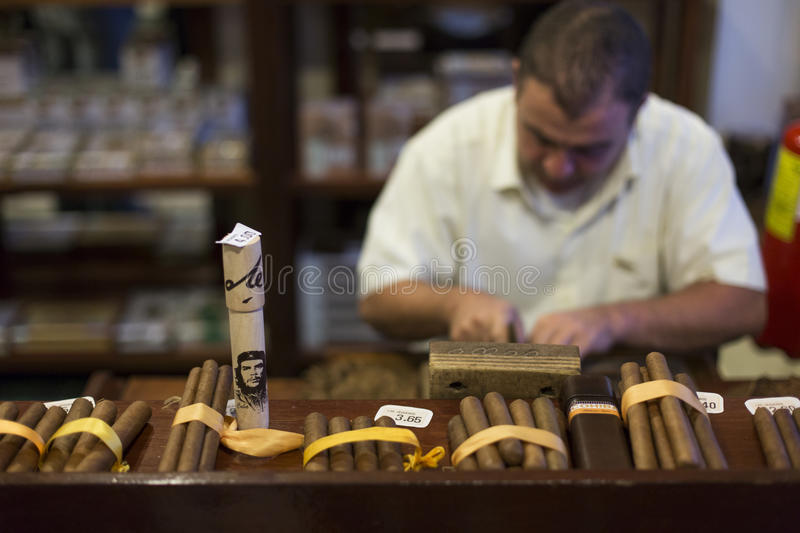 VINALES - FEBRUARY 19: Man processing the tobacco leaves and making cigars with simple tools on February 19, 2015 in stock photography