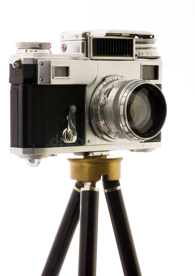 Vinatage Camera on tripod. Over white background stock photos