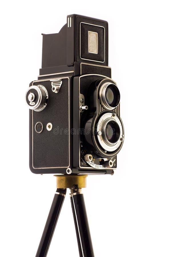 Vinatage Camera on tripod. Over white background royalty free stock photo
