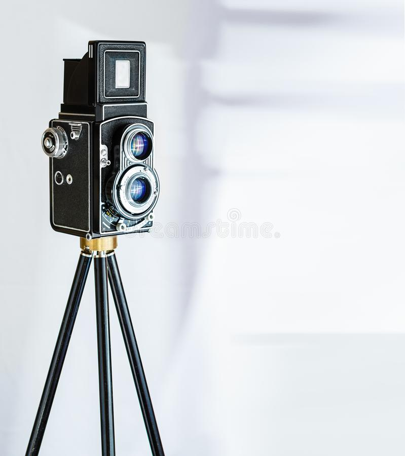 Vinatage Camera on tripod royalty free stock photography