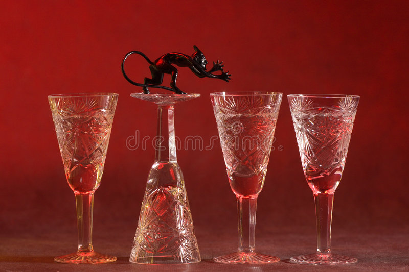 Vine-glases with devil stock images