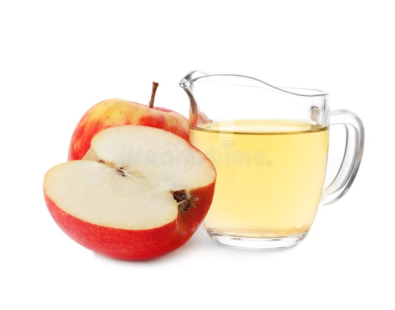 Vinegar in glass pitcher and fresh apples royalty free stock photos