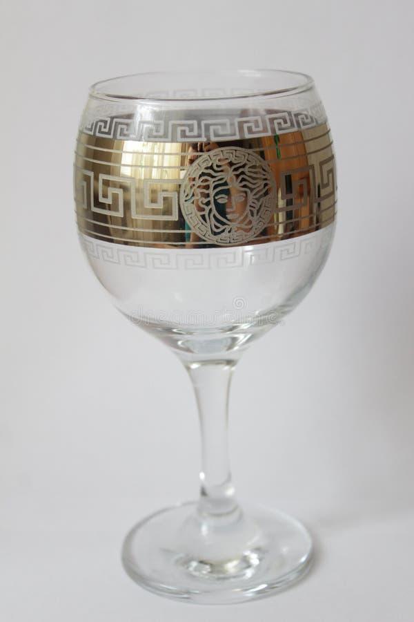 Vinexponeringsglas på vit bakgrund arkivbild