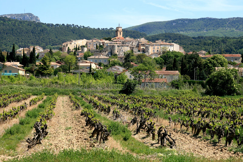 Vineyard and the village Sablet, France stock photography