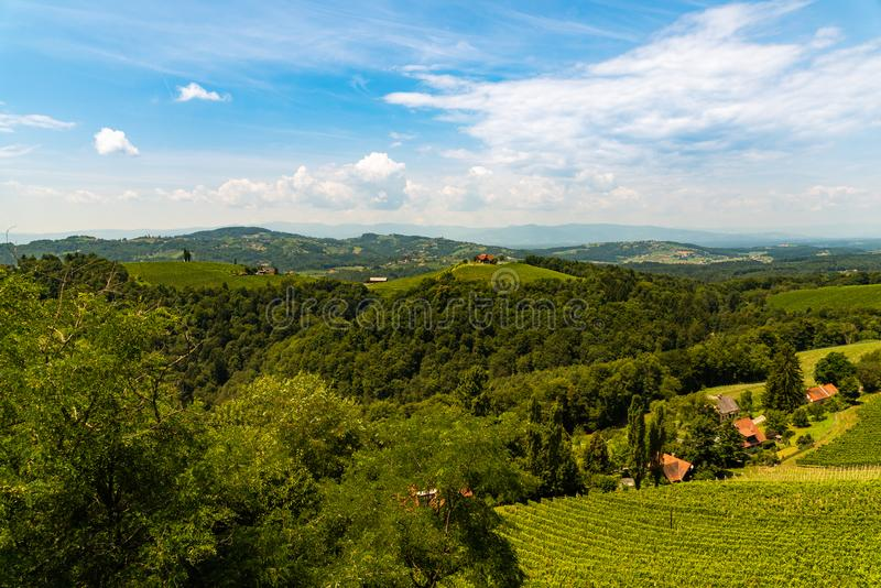 Vineyards in south styria in Austria. Landscape of Leibnitz area from Kogelberg. Tourist destination, Green hills of grape crops and mountains royalty free stock image