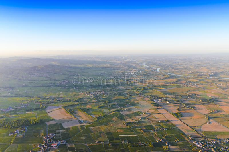 Vineyards and village in Beaujolais land royalty free stock photos