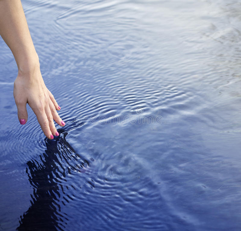 Vinger en water stock fotografie