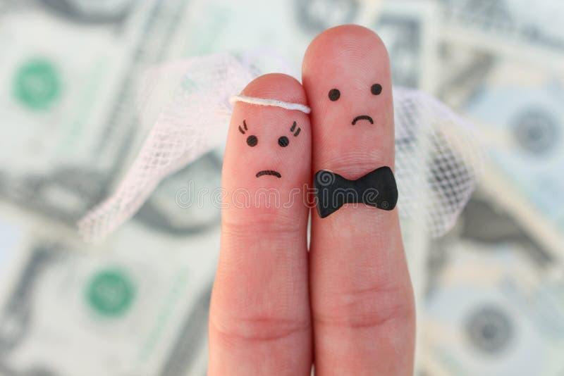 Vingerskunst van paar op achtergrond van geld Het concept huwelijk, vrouw en de mens moet gehuwd worden, maar zij trekken ` t wil royalty-vrije stock foto's