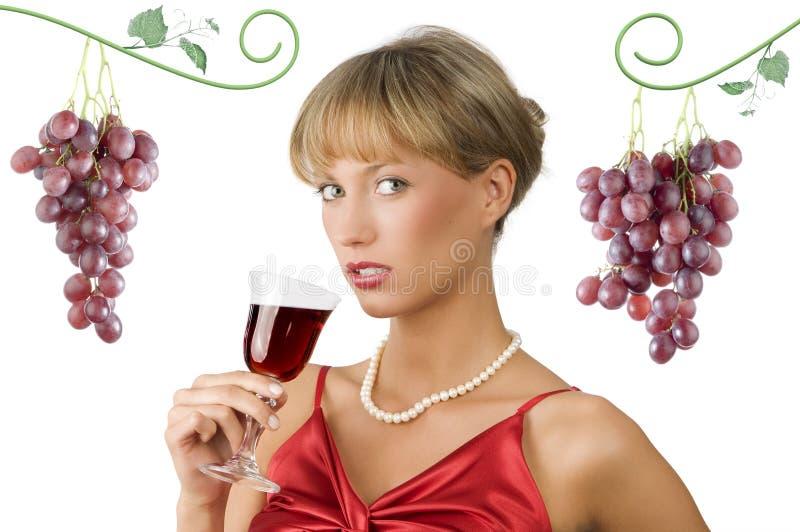 Vinho vermelho e vestido vermelho fotografia de stock royalty free