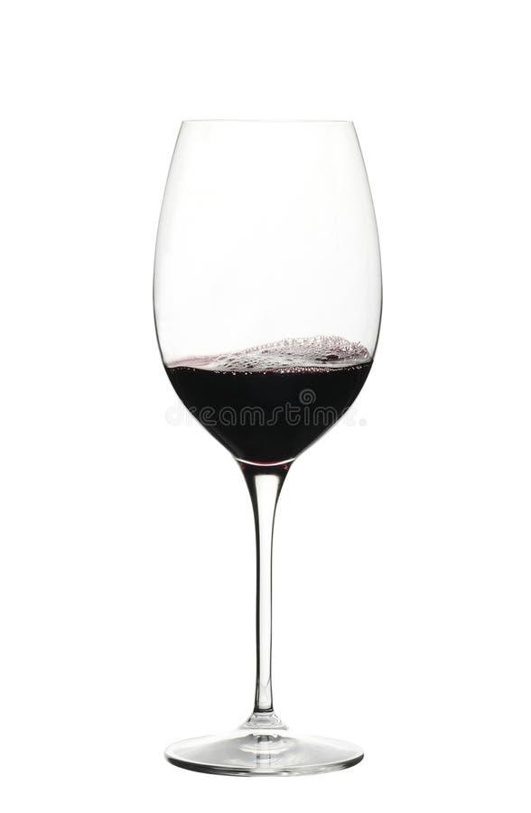 Vinho vermelho em um vidro isolado foto de stock