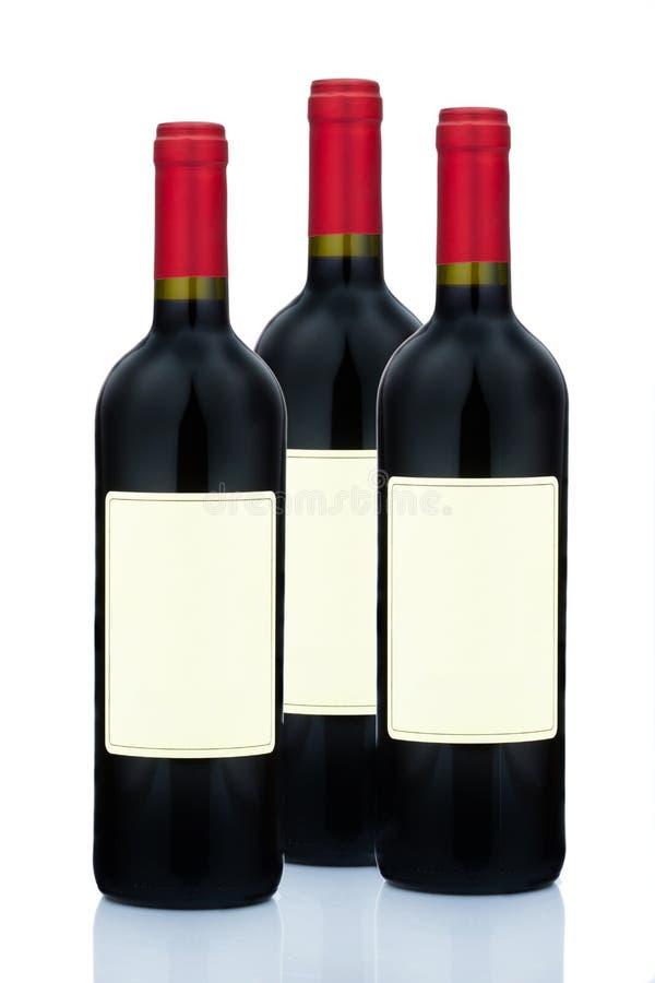 Vinho vermelho em uns frascos de vinho fotos de stock