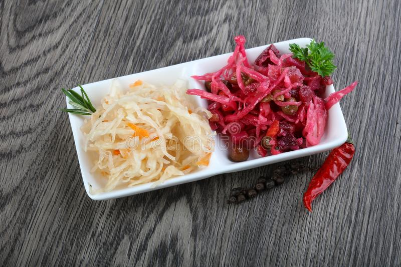 Viniagrette and fermented cabbage stock photos