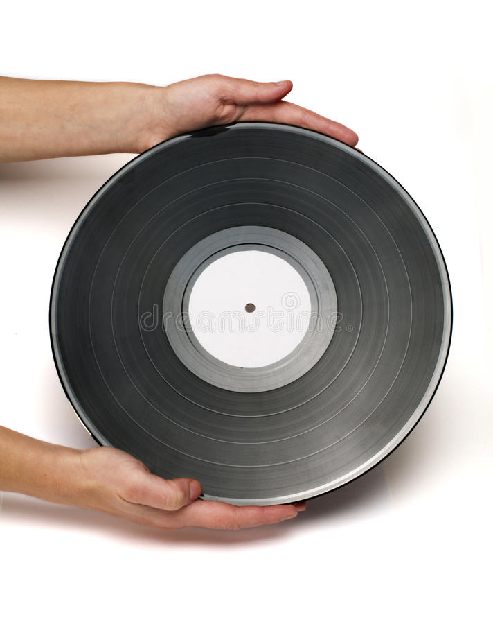 Vinil Record. Two hands hold Vinil Record white stock images
