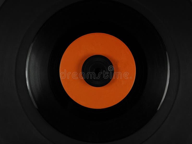 Vinilo en una estera de goma del disco del fonógrafo foto de archivo