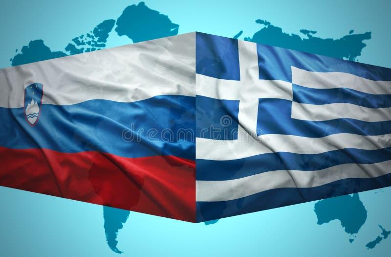 Vinka slovenska och grekflaggor royaltyfri bild