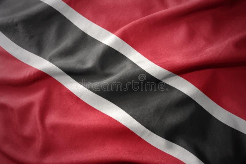 Vinkande färgrik flagga av Trinidad och Tobago royaltyfri foto