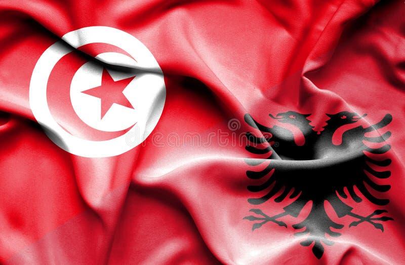 Vinkande flagga av Albanien och Tunisien stock illustrationer