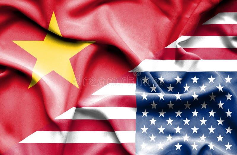 Vinkande flagga av Amerikas förenta stater och Vietnam royaltyfri fotografi
