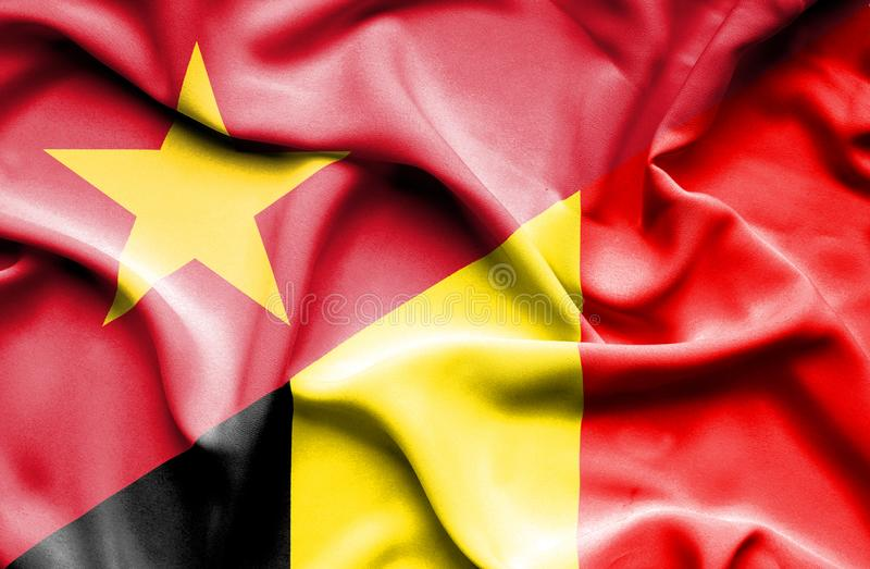 Vinkande flagga av Belgien och Vietnam stock illustrationer