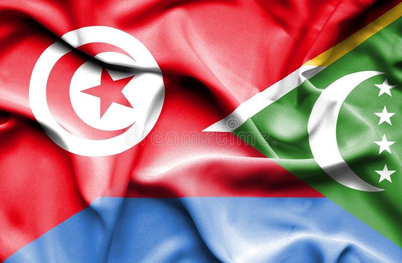 Vinkande flagga av Comoros och Tunisien stock illustrationer