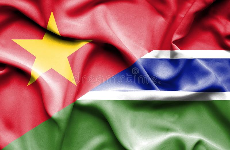 Vinkande flagga av Gambia och Vietnam stock illustrationer