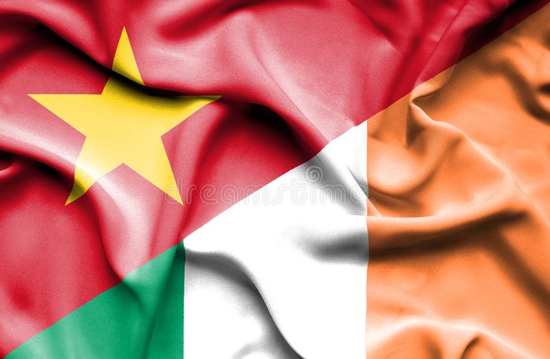 Vinkande flagga av Irland och Vietnam stock illustrationer