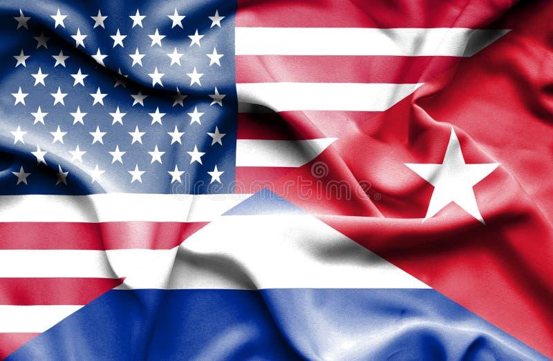 Vinkande flagga av Kuban och USA royaltyfri illustrationer