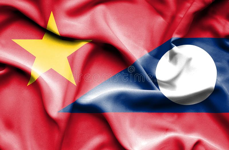 Vinkande flagga av Laos och Vietnam stock illustrationer