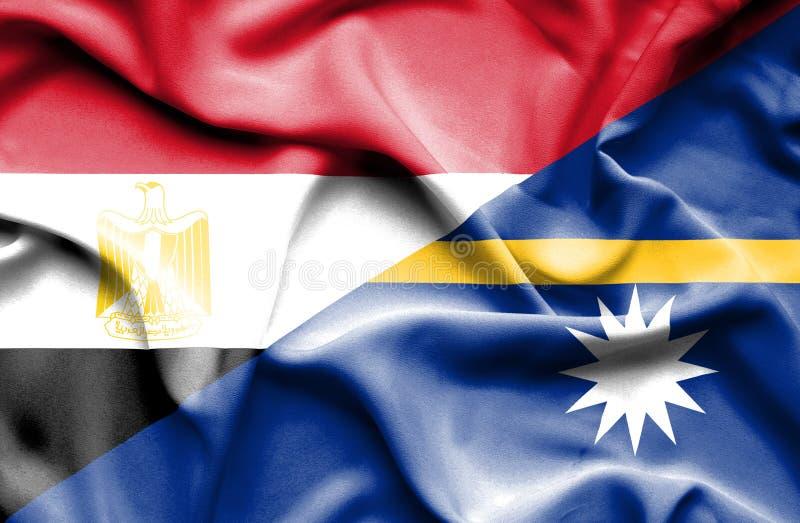 Vinkande flagga av Nauru och Egypten fotografering för bildbyråer