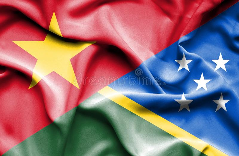Vinkande flagga av Solomon Islands och Vietnam stock illustrationer