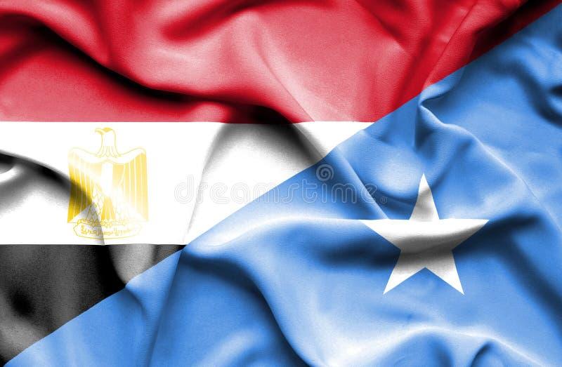 Vinkande flagga av Somalia och Egypten fotografering för bildbyråer