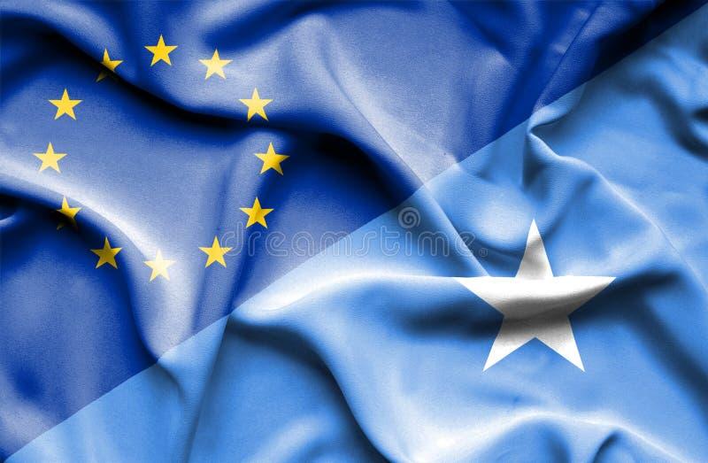 Vinkande flagga av Somalia och EU arkivfoton