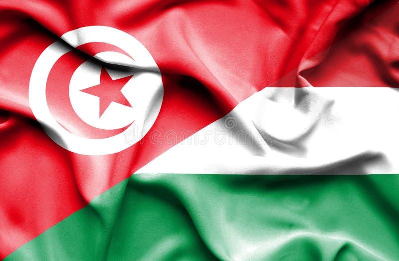 Vinkande flagga av Ungern och Tunisien stock illustrationer