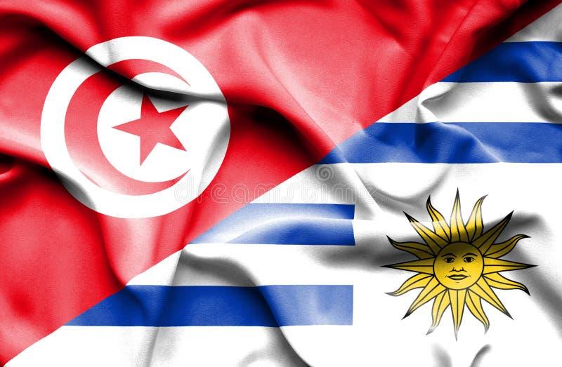 Vinkande flagga av Uruguay och Tunisien stock illustrationer